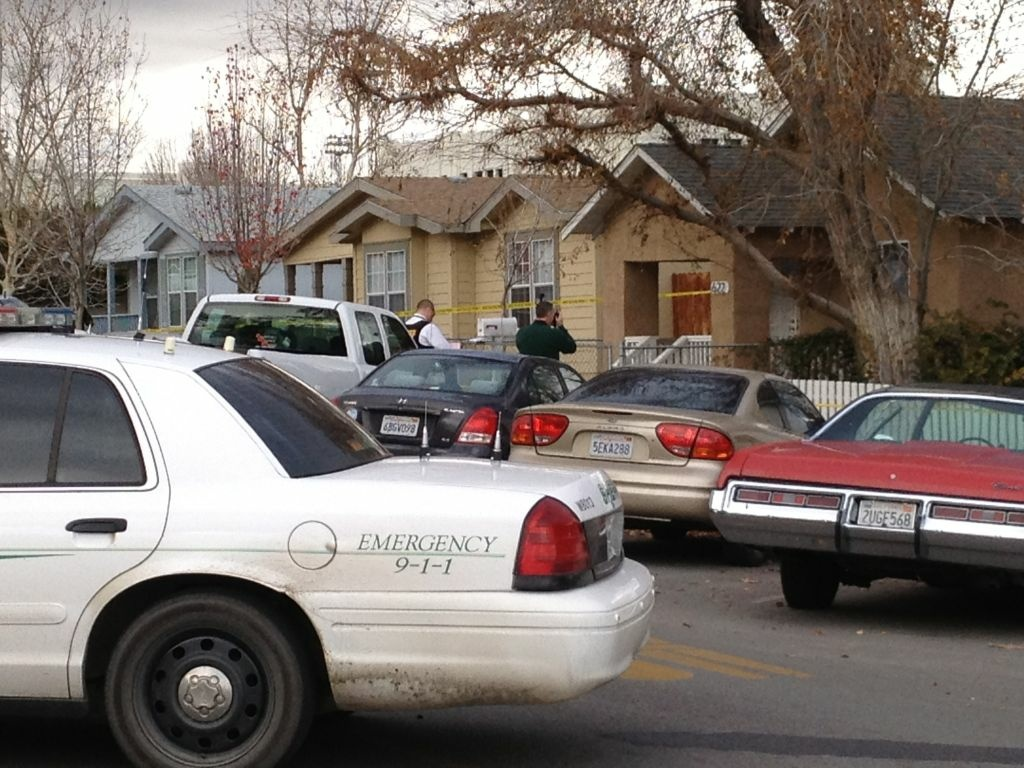 Police search a home, at right, believed to be the home of the Taft Union High School  shooter, who shot one student, in Taft, Calif., Thursday Jan. 10, 2013. The teen victim was in critical but stable condition. The shooter was later talked into surrendering and was taken into custody.