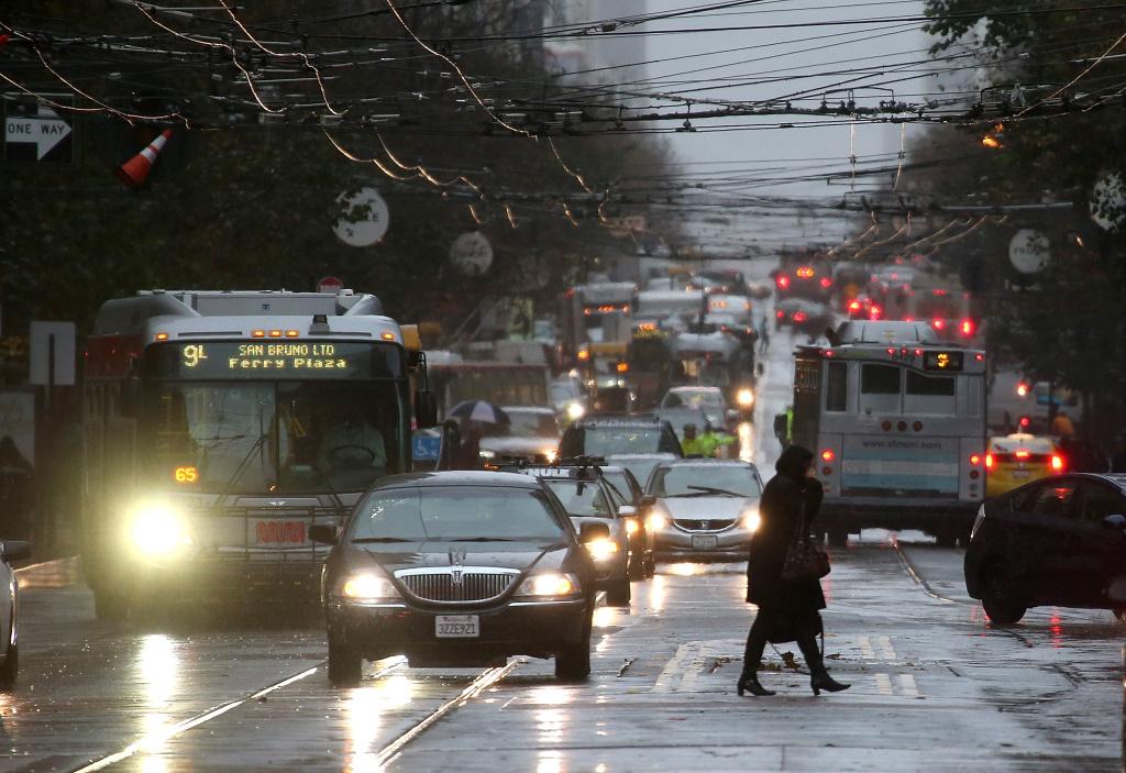 A pedestrian walks in the rain.