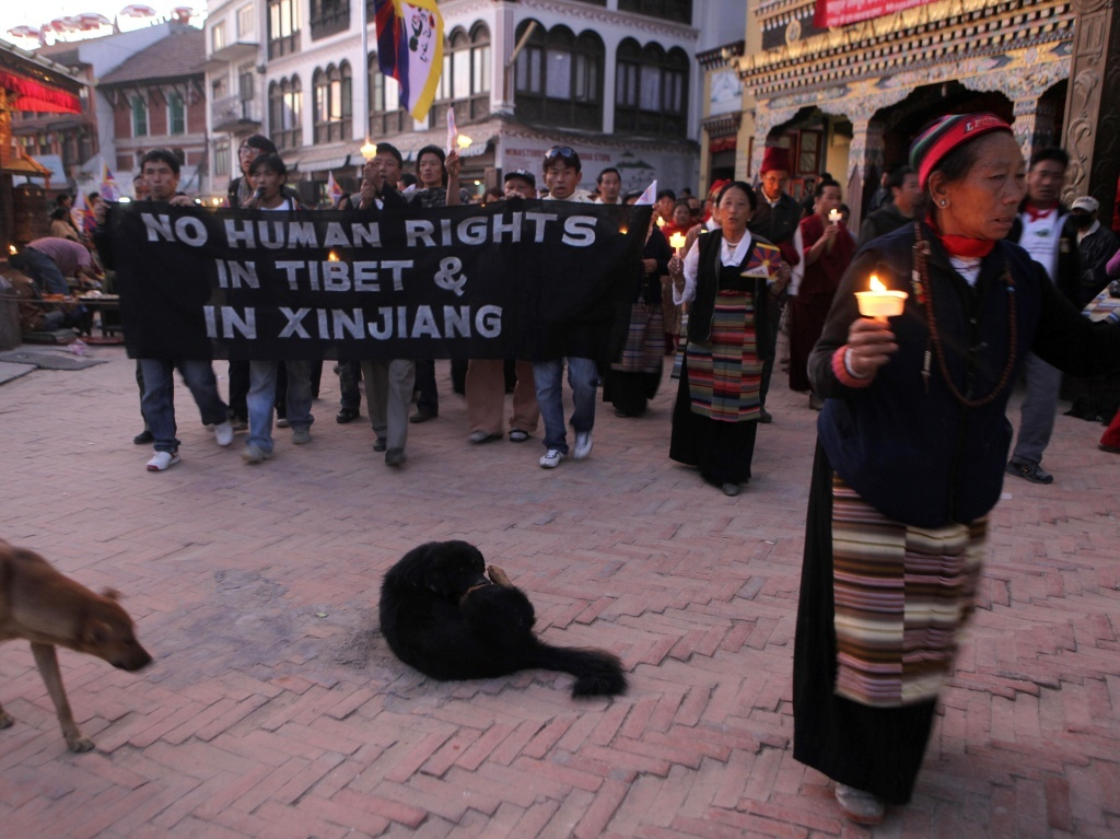 Exiled Tibetans march in November 2009 in Kathmandu, Nepal, during a protest against alleged human rights violations by the Chinese government in Tibet and Xinjiang.