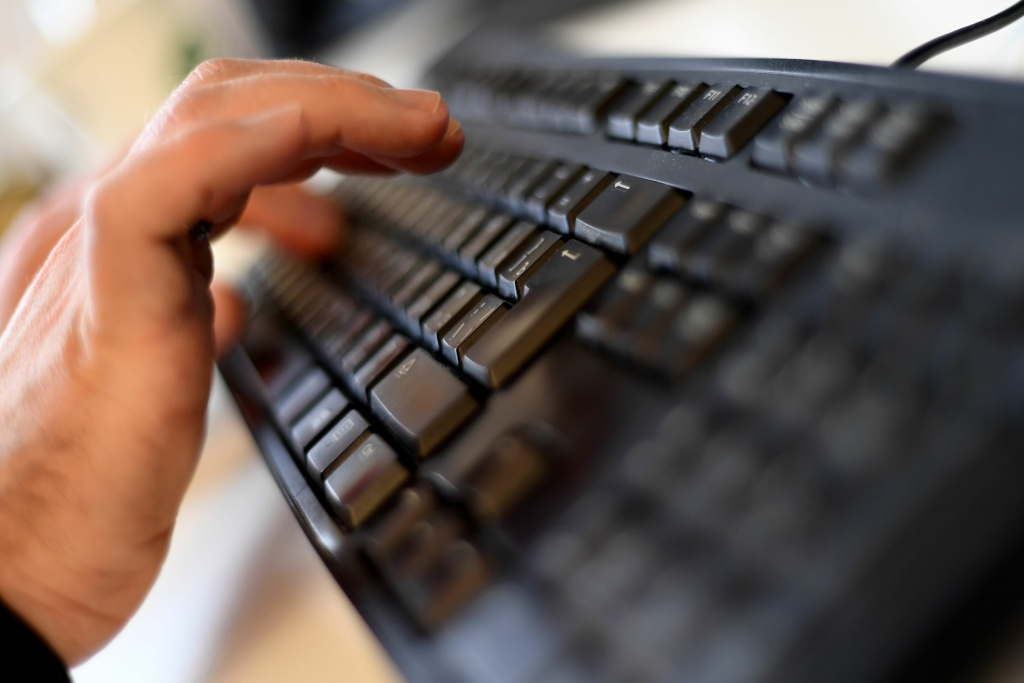 A picture taken on October 17, 2016 shows an employee typing on a computer keyboard at the headquarters of Internet security giant Kaspersky in Moscow.