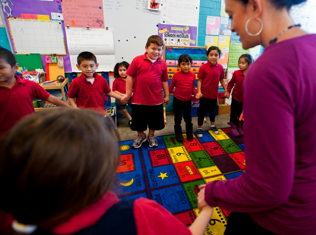 Kindergarteners sing a song to learn parts of the body in Spanish. The school was founded by principal Marcos Aguilar, a former Chicano activist and public school teacher.