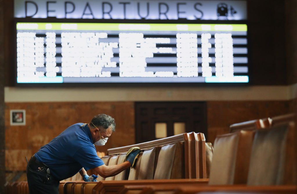 Seats in a waiting area are cleaned by a member of the custodial staff at Union Station on March 13, 2020 in Los Angeles, California. L.A.
