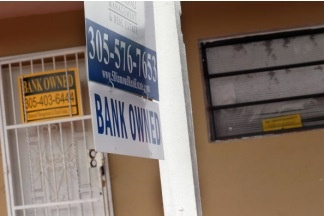 A bank owned sign hangs in front of a foreclosed home on October 14, 2010 in Miami, Florida. Bank repossessions rose to their highest level in September, exceeding 100,000 in a month for the first time, according to foreclosure tracker RealtyTrac.