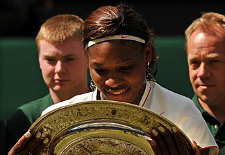 Serena Williams of US looks at her trophy after defeating Vera Zvonareva of Russia 6-3, 6-2, in the Women's Final at the Wimbledon Tennis Championships at the All England Tennis Club, in south-west London, on July 3, 2010.