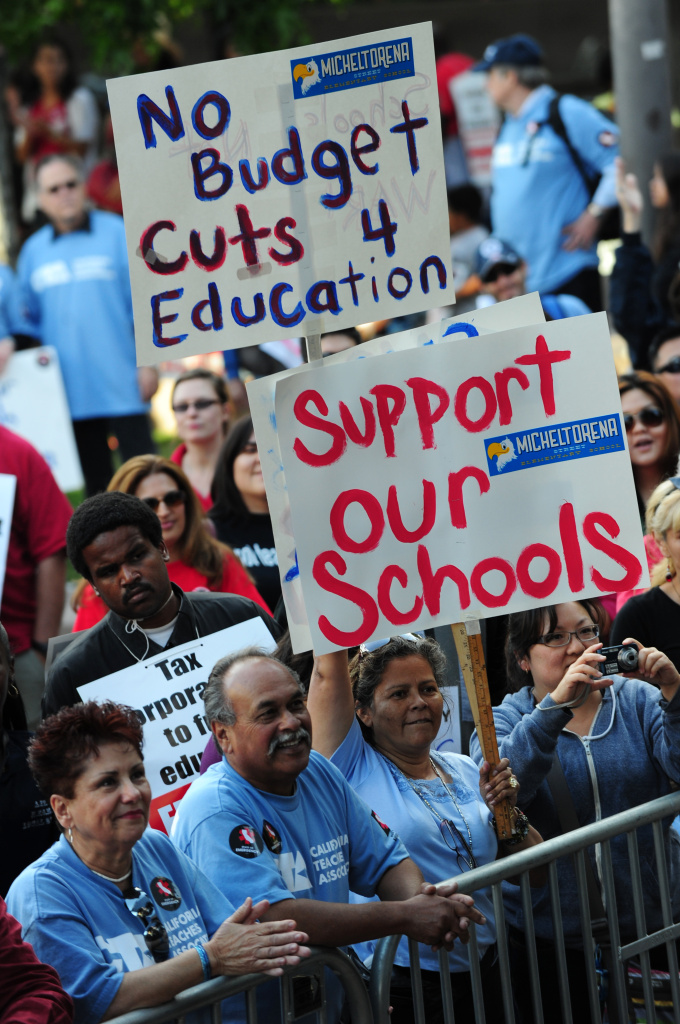Teachers and students from California demonstrate at a ``state of emergency'' rally to protest potential statewide cuts of up to $4 billion in education spending, in Los Angeles, California on May 13, 2011.