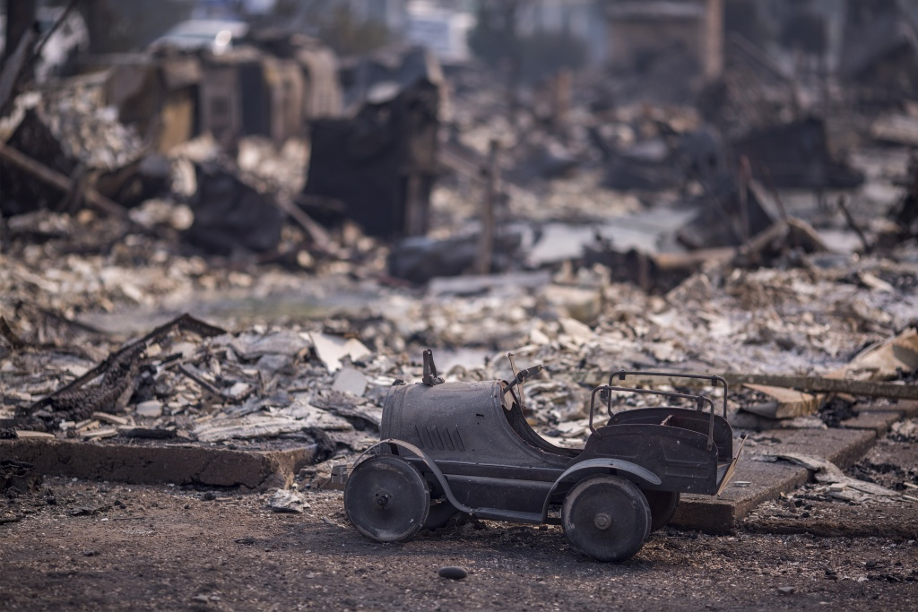 A toy car is left scorched in a neighborhood destroyed by fire near Cardinal Newman High School on October 10, 2017 in Santa Rosa, California.