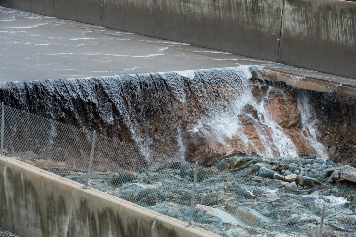 Water flowing over the Oroville Dam spillway on Saturday, Feb. 11, 2017.