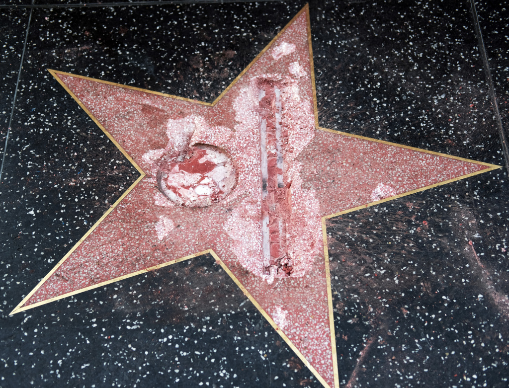 The vandalized star for Republican presidential candidate Donald Trump is seen on the Hollywood Walk of Fame, Wednesday, Oct. 26, 2016, in Los Angeles. Detective Meghan Aguilar said investigators were called to the scene before dawn Wednesday following reports that Trump's star was destroyed by blows from a hammer.