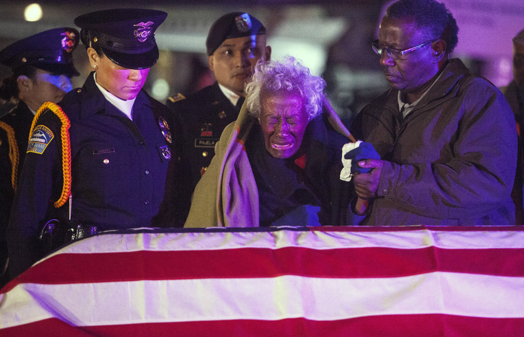 Clara Gantt, the 94-year-old widow of U.S. Army Sgt. Joseph Gantt, weeps in front of her her husband's casket.