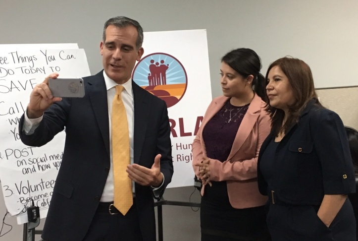 Los Angeles Mayor Eric Garcetti makes a call to a voter during a phone bank effort at the offices of the Coalition for Humane Immigrant Rights of Los Angeles on Tuesday, Aug. 29, 2017. He urged voters to help support Deferred Action for Childhood Arrivals program, or DACA, but acknowledged the city can't do much if President Trump rescinds the program.
