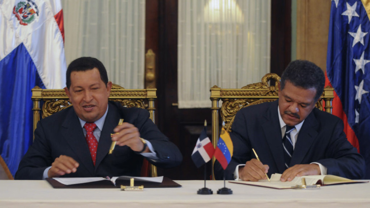 The Dominican Republic's President Leonel Fernandez, right, and Venezuela's President Hugo Chavez sign an agreement in 2010. The Dominican Republic gets about 40,000 barrels of oil a day from Venezuela.