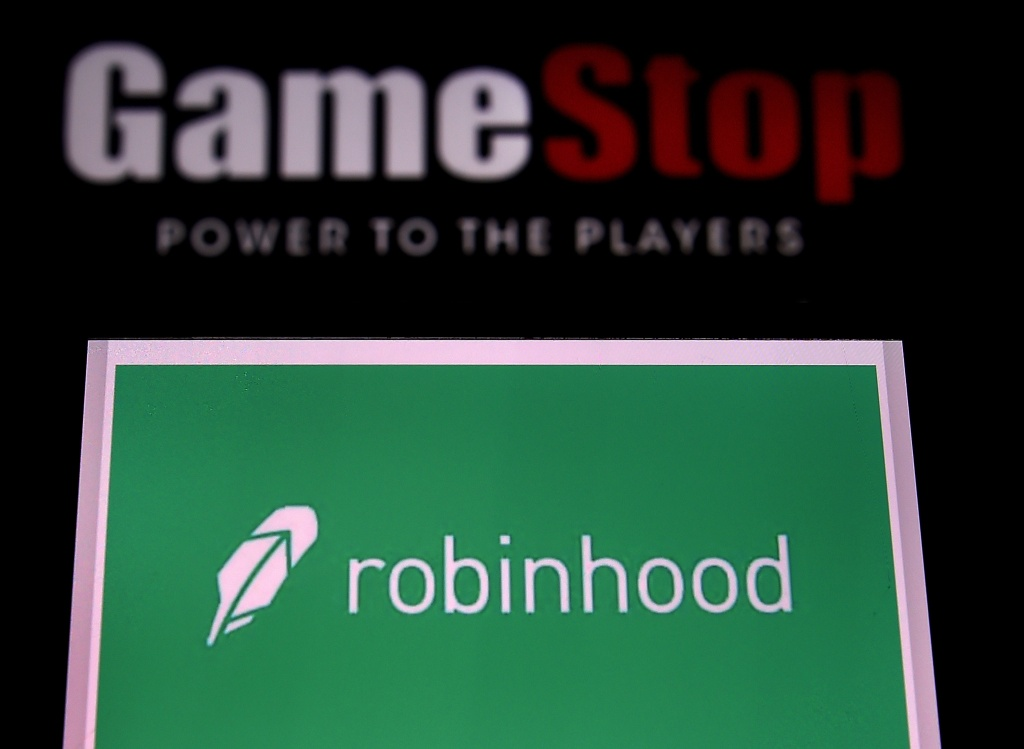 This photo illustration shows the logos of video grame retail store GameStop and trading application Robinhood on a computer and on a mobile phone in Arlington, Virginia on January 28, 2021.