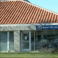 Irvine-based Banc of California's bid to acquire 20 branches from Banco Popular is facing opposition from advocates for low-income and minority communities.