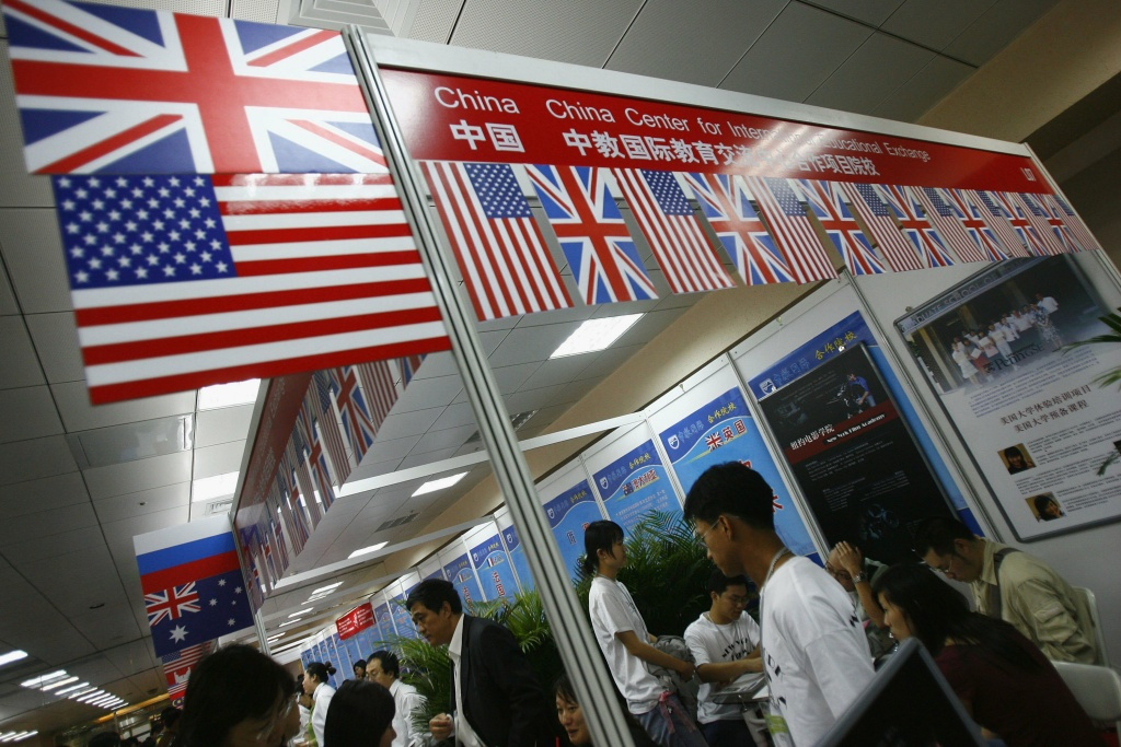 Visitors inquire about schools of USA, UK and other countries at the 2006 China Education Expo on October 14, 2006 in Beijing, China. The fair has attracted over 450 colleges, universities, schools and institutions from about 30 countries and regions present. Chinese students have become popular student source for foreign schools which are developing overseas education market in China, according to local media.