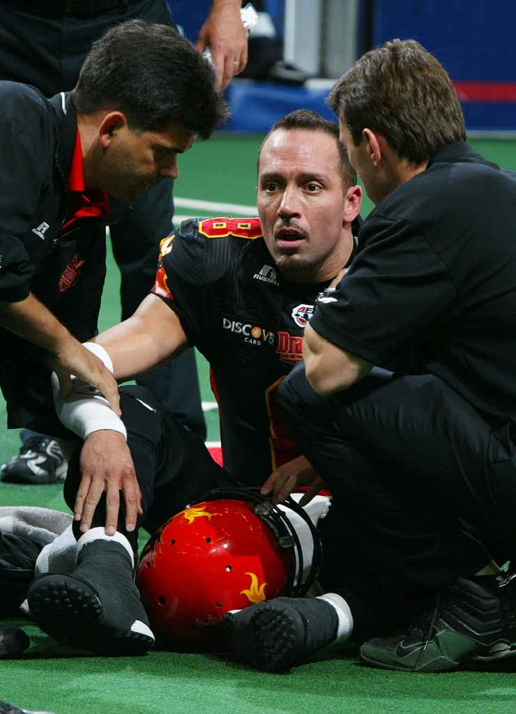 Quarterback Aaron Garcia #8 of the New York Dragons is attended to by the trainers after suffering a mild concussion during the first half. Garcia did not return for the remainder of the game against the Philadelphia Soul on May 18, 2008 at Nassau Coliseum in Uniondale, New York. The Soul defeat the Dragons 59-30.