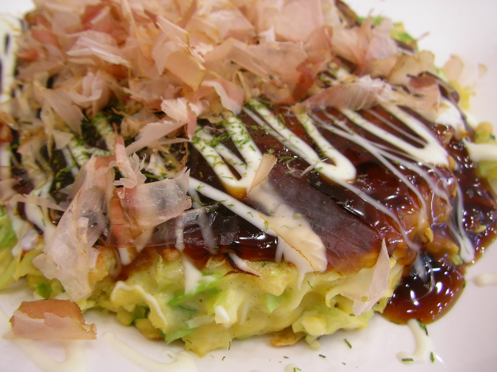 Okonomiyaki, a type of Japanese pancake.