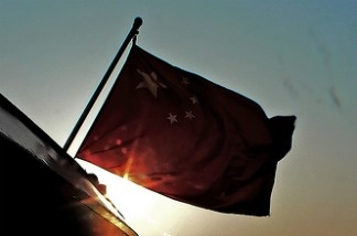 A Chinese flag flies over Xiamen Harbour, China.