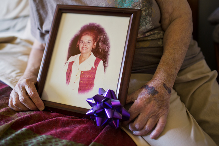 Alice Herman, 78, holds photographs of herself and her partner of 45 years, Sylvia. Herman lives at Triangle Square, an elder care facility in Hollywood mainly for LGBT seniors.