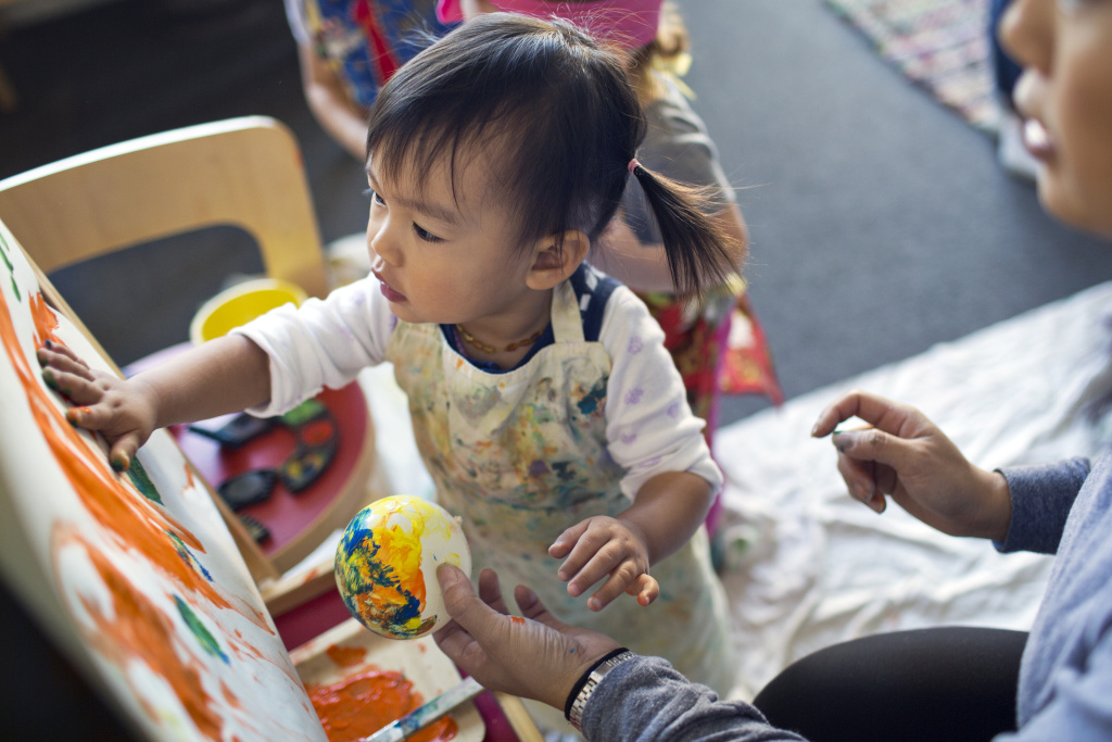 Twenty-two-month-old Maya Luu Guayasamin takes part in an art class in Long Beach on Thursday morning, Nov. 12, 2015 at The Family Nest, which provides bilingual early childhood education classes.