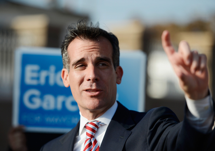 Councilman Eric Garcetti, candidate in the Los Angeles City mayoral race, greets supporters as he arrives aboard a train to visit business around Metro Gold Line's Mariachi Plaza Station during a campaign stop on March 4, 2013 in Los Angeles, California.
