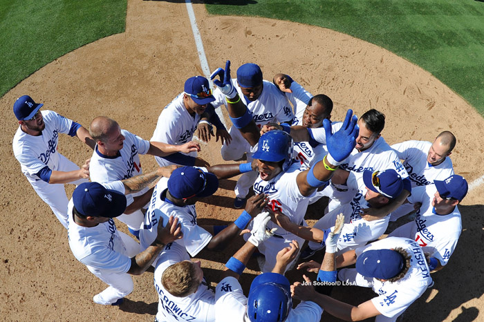 Los Angeles Dodgers Yasiel Puig celebrates his walk off home run with teammates against the Cincinnati Reds Sunday, July 28, 2013 at Dodger Stadium in Los Angeles,California.  The Dodgers beat the Reds 1-0.
