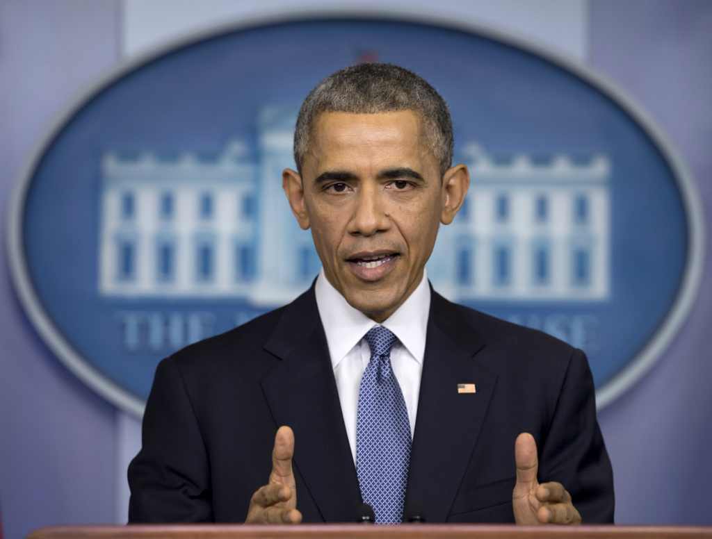 In this Dec. 19, 2014 file photo, President Barack Obama speaks during a news conference in the Brady Press Briefing Room of the White House in Washington to talk about successes in 2014, citing lower unemployment, a rising number of Americans covered by health insurance, and an historic diplomatic opening with Cuba.  The Obama administration is putting a large dent in the U.S. embargo against Cuba as of Friday, significantly loosening restrictions on American trade and investment. The new rules also open up the communist island to greater American travel and allow U.S. citizens to start bringing home small amounts of Cuban cigars after more than a half-century ban.