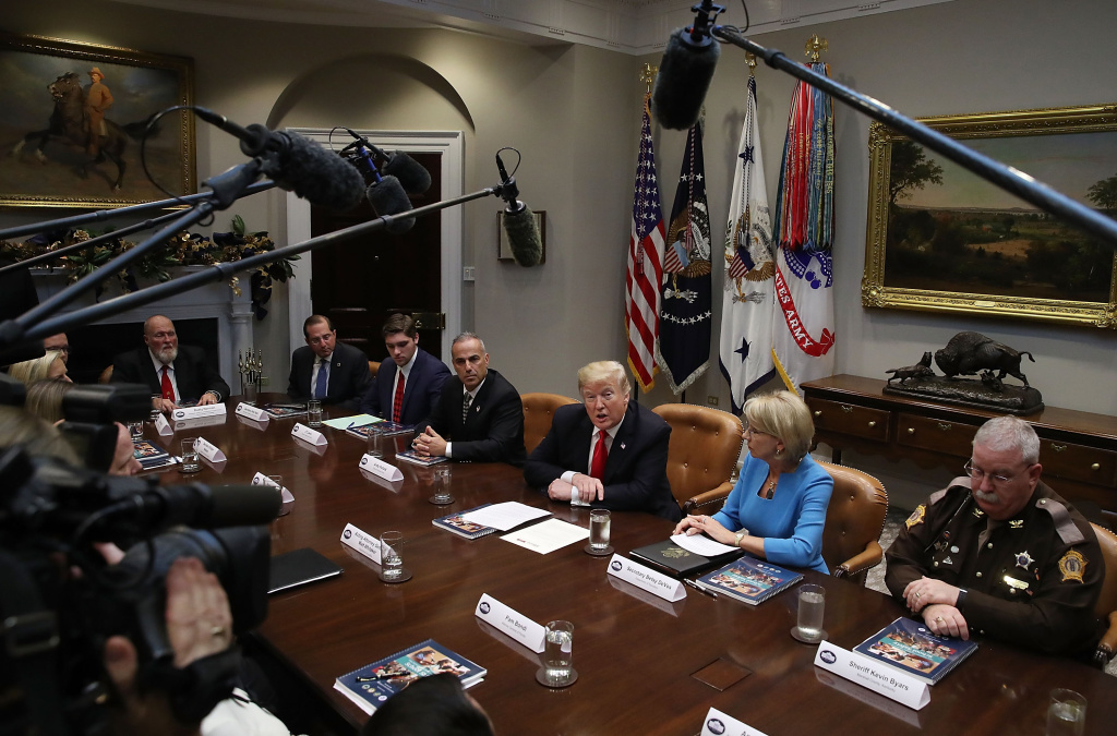 U.S. President Donald Trump leads a roundtable discussion on school safety and the new Federal Commission on School Safety report with family members of shooting victims, along with state and local officials, in the Roosevelt Room at the White House on December 18, 2018 in Washington, DC.