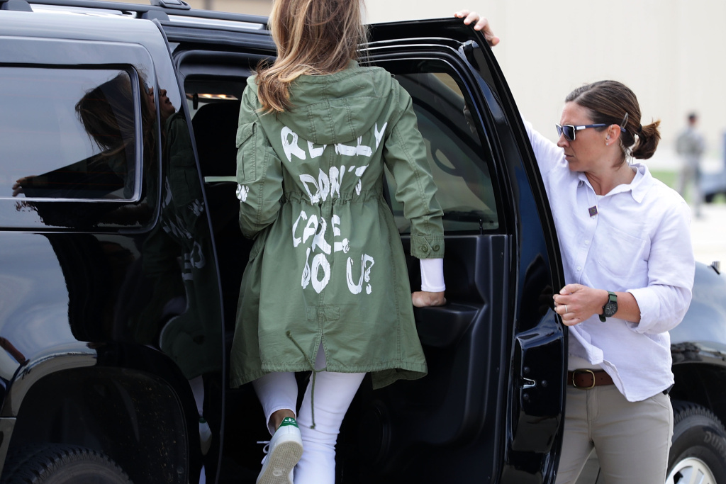 U.S. first lady Melania Trump (C) climbs back into her motorcade after traveling to Texas to visit facilities that house and care for children taken from their parents at the U.S.-Mexico border June 21, 2018 at Joint Base Andrews, Maryland.