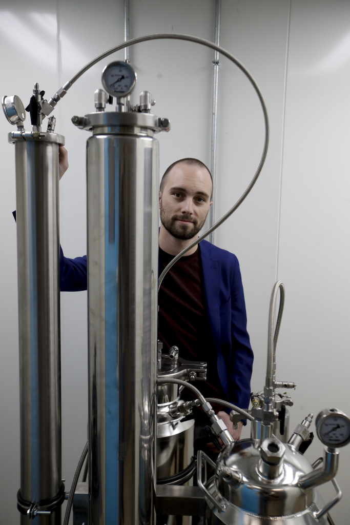 Jordan Lams, CEO of Moxie, poses for a picture next to a precision extractor Thursday, Dec. 14, 2017, in Lynwood, California. Pure CA, which does business as Moxie brand products, a company known for its cannabis extracts, was awarded the first temporary license in the state.