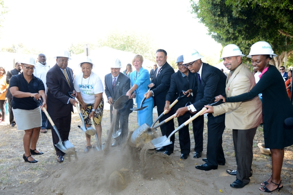 Community leaders, including Congresswoman Janice Hahn (in blue), break ground on Altamed's senior health center in Watts. It's projected to open in the spring of 2014.