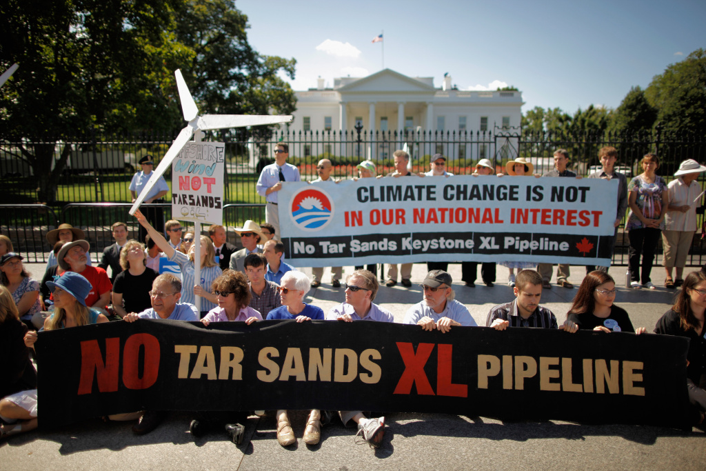More than 50 demonstrators sit down in front of the White House along Pennsylvania Avenue while protesting agains a proposed pipeline that would bring tar sands oil to the U.S. from Canada August 22, 2011 in Washington, DC.