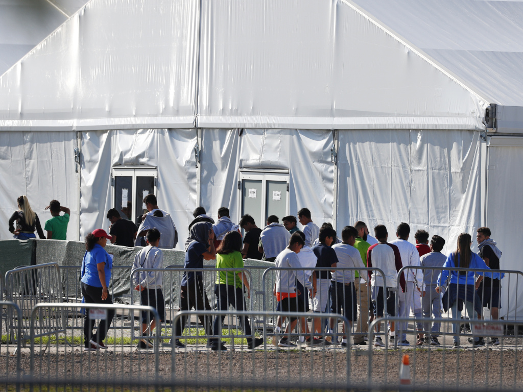 Children line up to enter a tent at the Homestead Temporary Shelter for Unaccompanied Children in Homestead, Fla., in February.