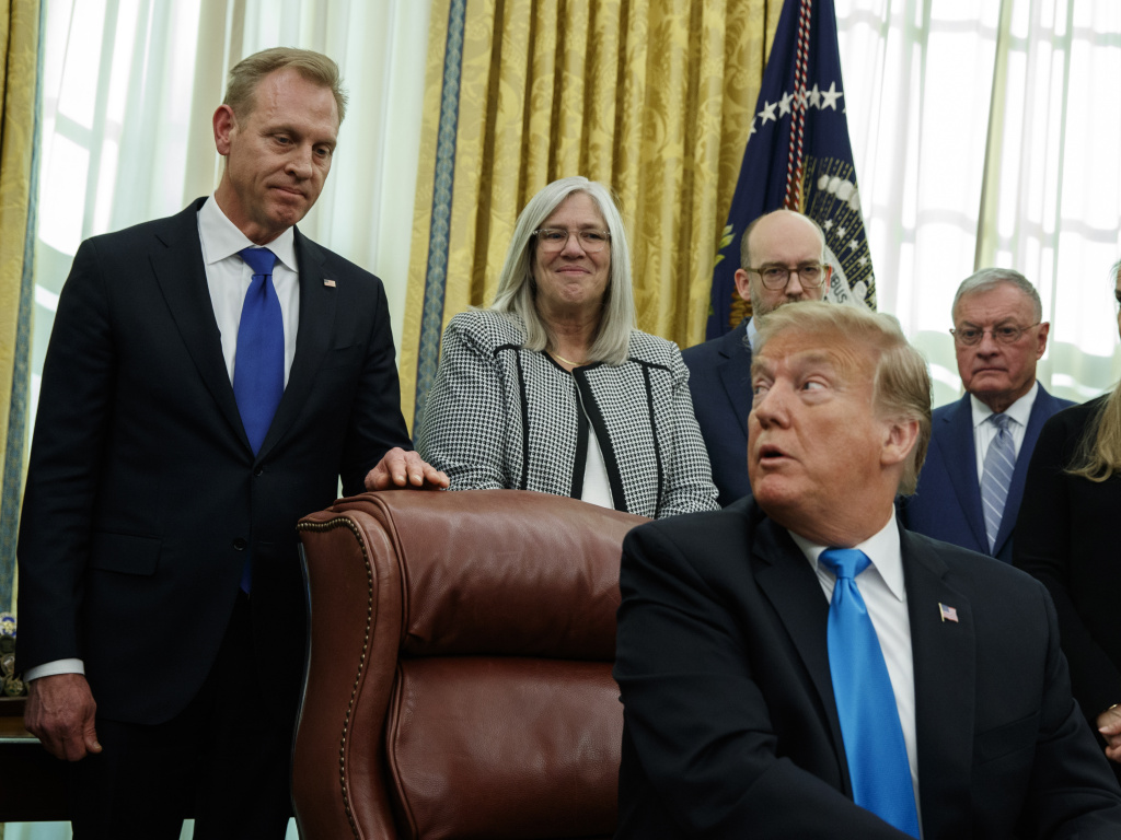 Acting Secretary of Defense Patrick Shanahan listens as President Trump speaks during a signing event for
