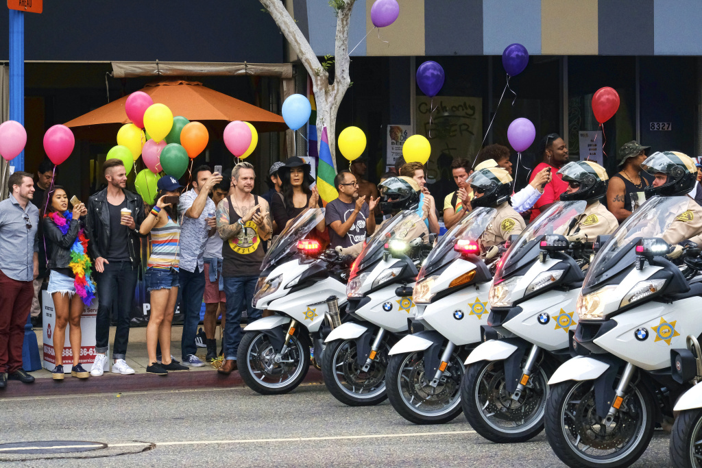 Los Angeles County Sheriff's department motorcycle deputies ride along a street in West Hollywood, Calif., during the Gay Pride Parade on Sunday, June 12, 2016. A heavily armed man arrested in Southern California told police he was in the area for West Hollywood's gay pride parade.