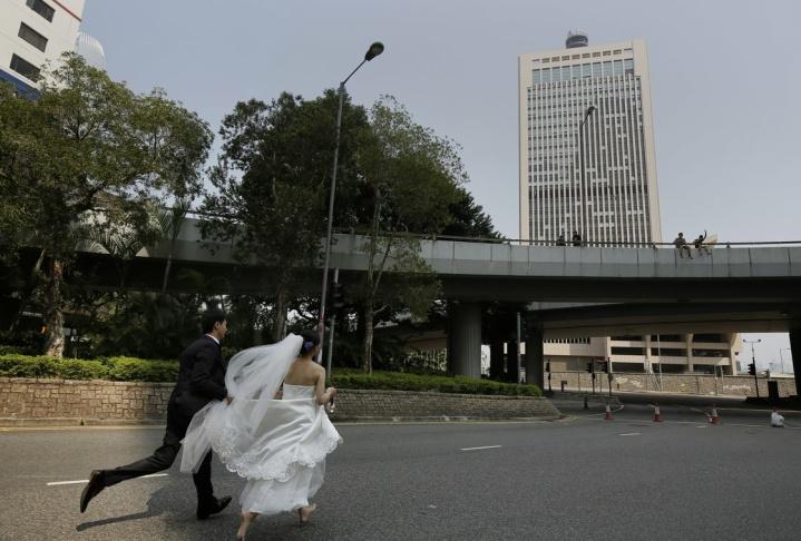 Hong Kong wedding couple running