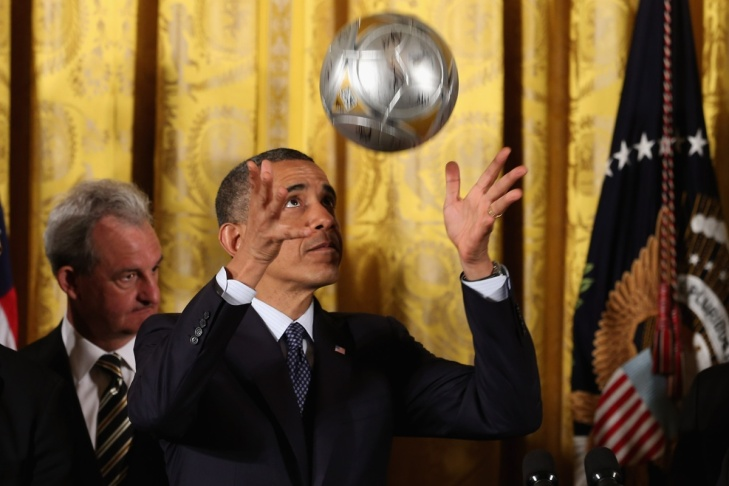 President Barack Obama bounces a soccer ball off his head during an event in the East Room of the White House March 26, 2013 in Washington, DC.