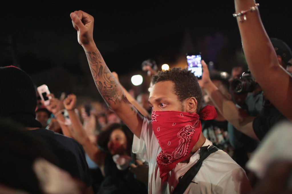 Demonstrators protesting the acquittal of former St. Louis police officer Jason Stockley march through University City on September 16, 2017 in St. Louis, Missouri.