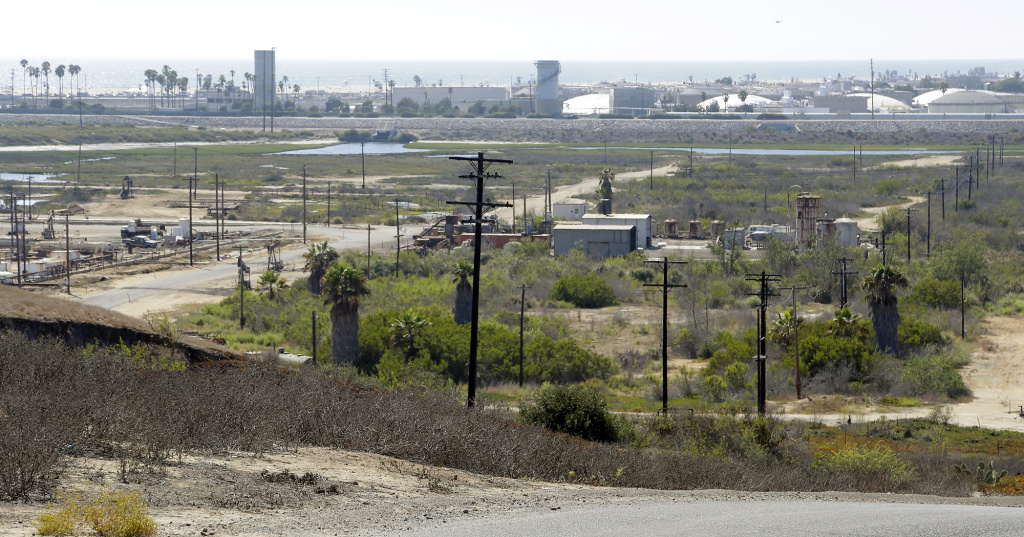 This Aug. 18, 2016, photo shows Banning Ranch, including what remains of an oil-extraction operation, on what is believed to be the biggest piece of privately-owned vacant land on Southern California's coast in Newport Beach, Calif.