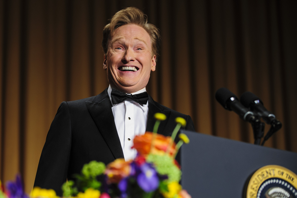 Comedian Conan O'Brien delivers a comedy routine during the White House Correspondents' Association Dinner on April 27, 2013 in Washington, DC. The dinner is an annual event attended by journalists, politicians and celebrities.