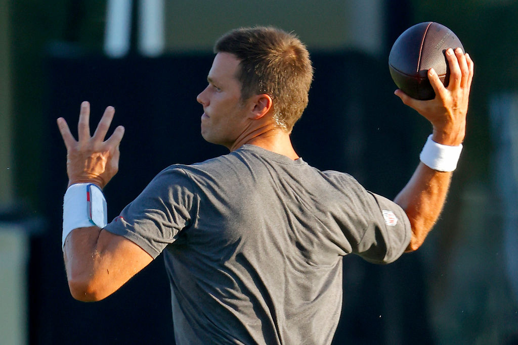 Tom Brady #12 of the Tampa Bay Buccaneers works out during a practice at AdventHealth Training Center on August 04, 2020 in Tampa, Florida.