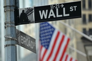 Street signs at the corner of Wall and Broad Streets at the New York Stock Exchange.