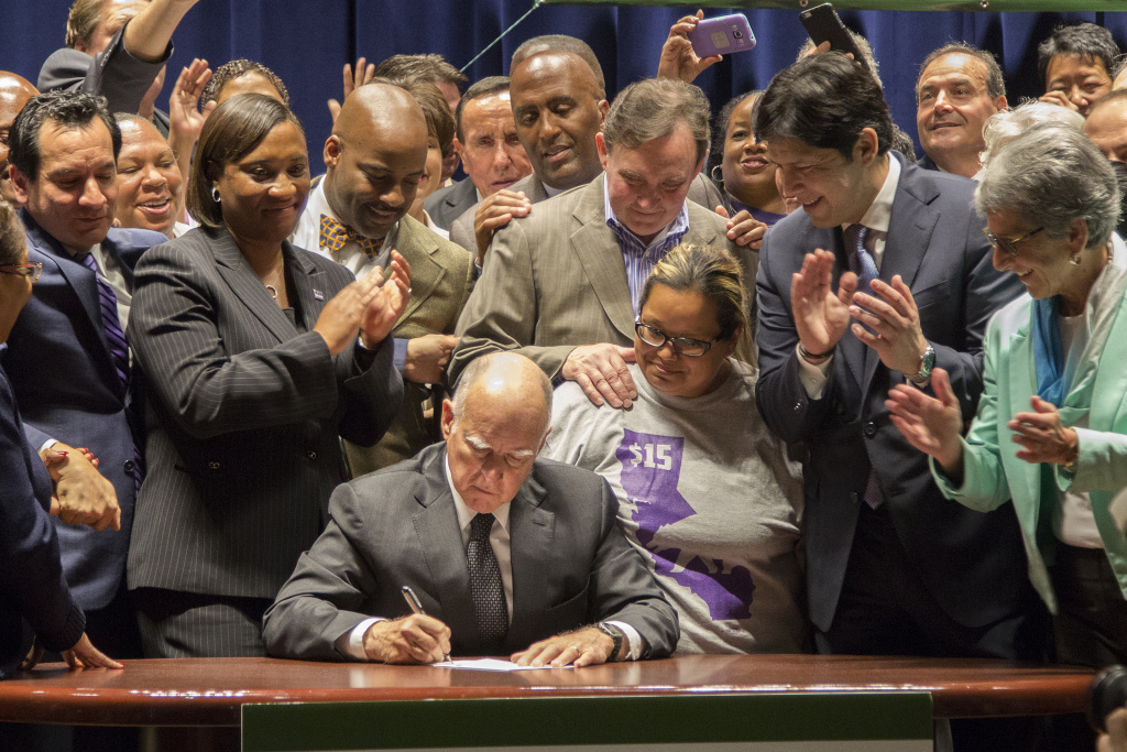 California Governor Jerry Brown signs landmark legislation SB 3 into law on April 4, 2016 in Los Angeles, California.