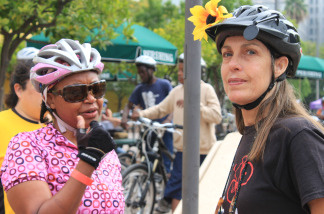 Vanessa Gray of Silver Lake (left) and her friend Alice Strong (right) of San Gabriel meet on Pershing Square just before their 18-mile bike tour through Los Angeles on June 27, 2010.