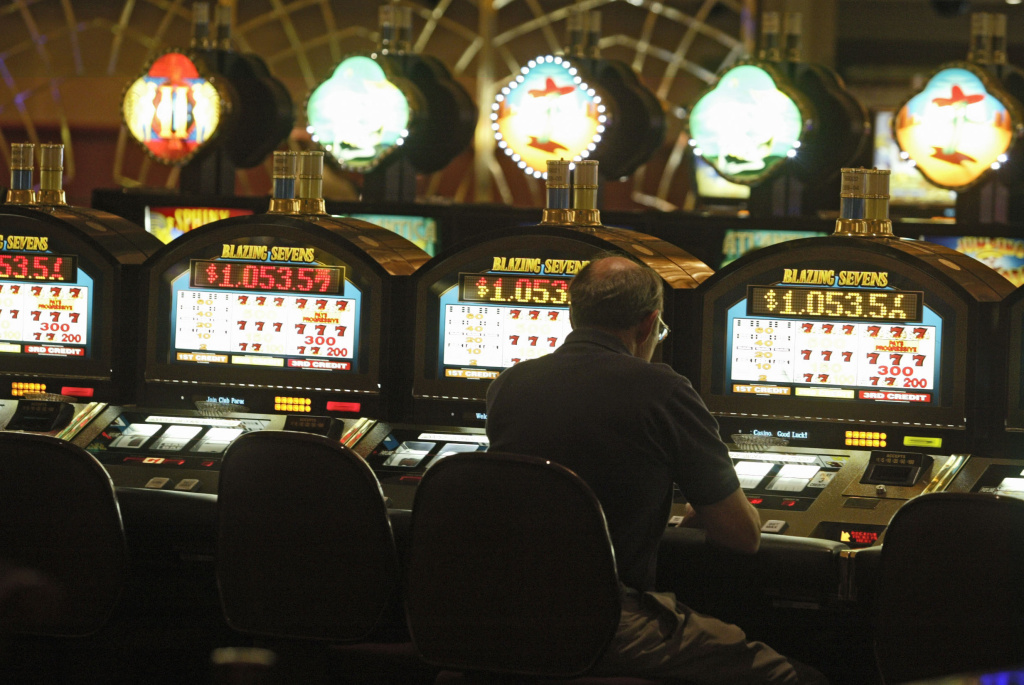 In this file photo, a patron plays a slots machine Friday, Oct. 22, 2004, at the SPA Resort Casino in Palm Springs, Calif. Proposition 48 would allow the North Fork Rancheria of Mono Indians to establish a new casino with up to 2,000 slot machines in Madera County.
