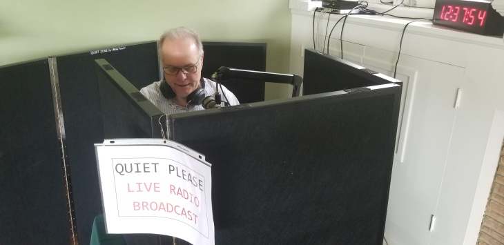 Pictured: Larry broadcasting AirTalk from the Mantle household for the first time last Friday.