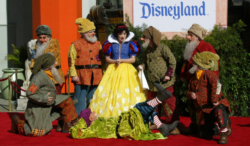 Snow White and the Seven Dwarfs perform during the handprint ceremony at Grauman's Chinese Theatre on February 5, 2004 in Hollywood, California.