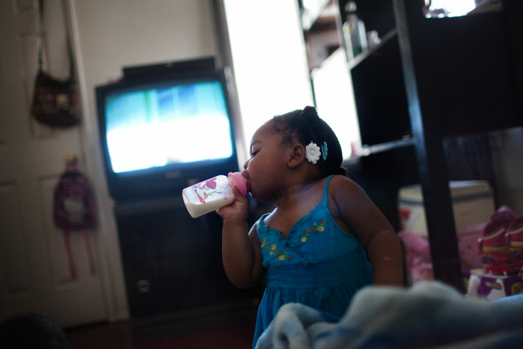 Darniyah Davis, 1, watches TV at her mother's home in Compton on October 3rd, 2012.