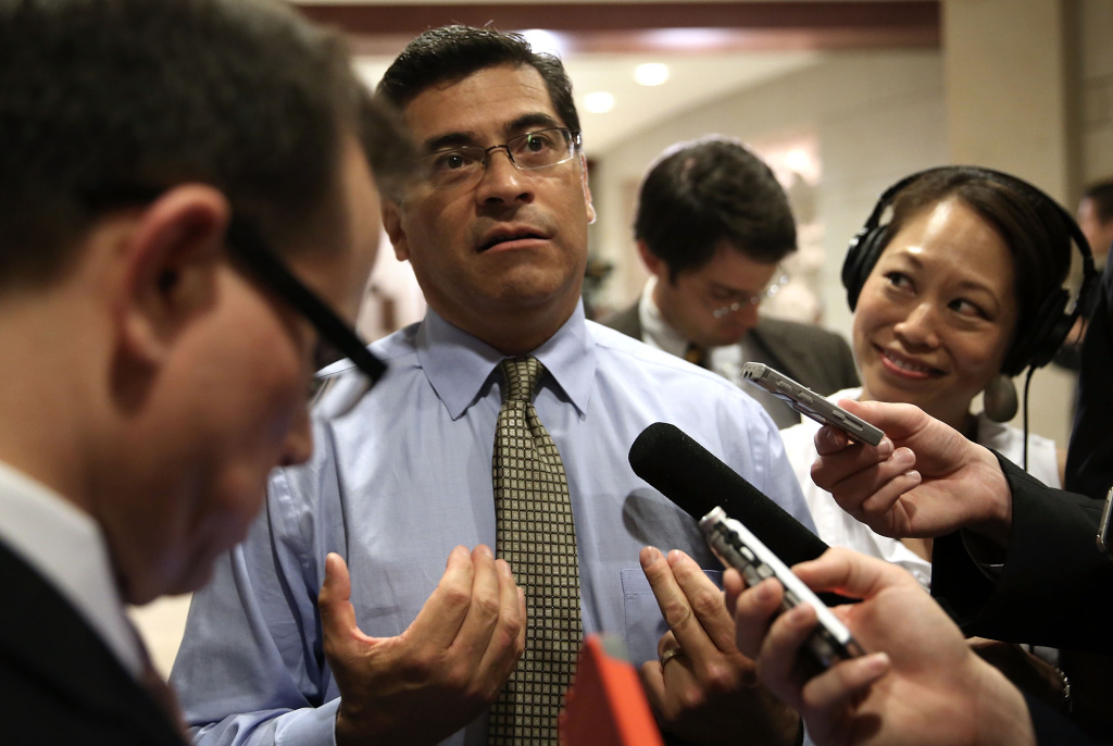 U.S. Rep. Xavier Becerra (D-CA) speaks to members of the media as he arrives at a closed briefing for members of the House of Representatives June 11, 2013 on Capitol Hill in Washington, DC.