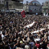 Palestinian mourners carry the body of three senior commanders of the Hamas military wing in the southern Gaza Strip Thursday, after they were killed in an Israeli airstrike. Hamas has executed more than a dozen people it says were spying for Israel.