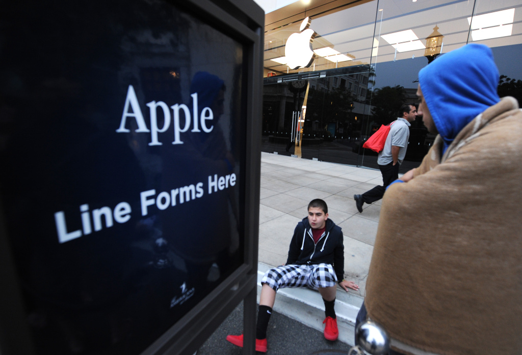 People wait to purchase the new Apple iPhone 5S and 5C in the front of the line outside of the Apple Store at the Americana at Brand shopping complex in Glendale on Sept. 20, 2013.